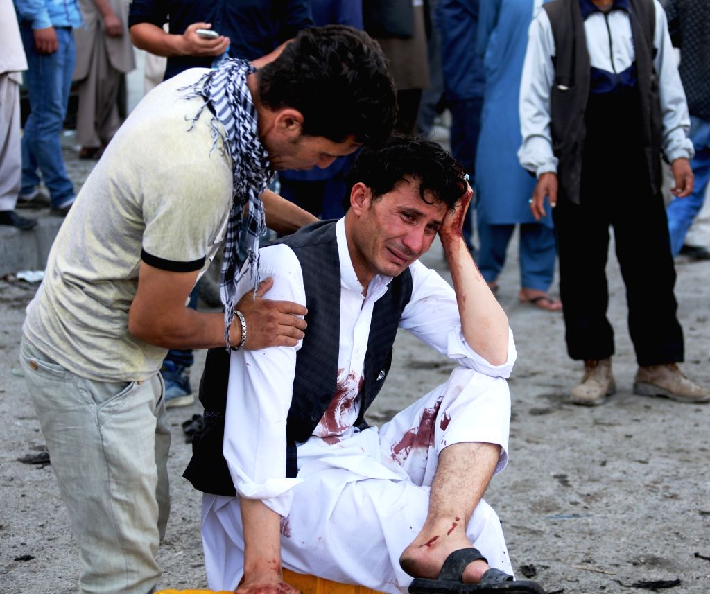 KABUL, July 23, 2016 - An injured man cries at the site of a blast in Kabul, capital of Afghanistan, July 23, 2016. At least 61 people were killed and some 207 others wounded after a deadly blast hit ...