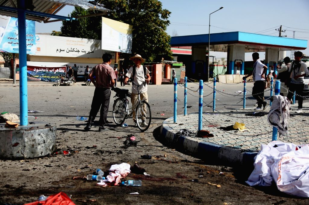 KABUL, July 23, 2016 - People stand at the site of a blast in Kabul, capital of Afghanistan, July 23, 2016. At least 61 people were killed and some 207 others wounded after a deadly blast hit a ...