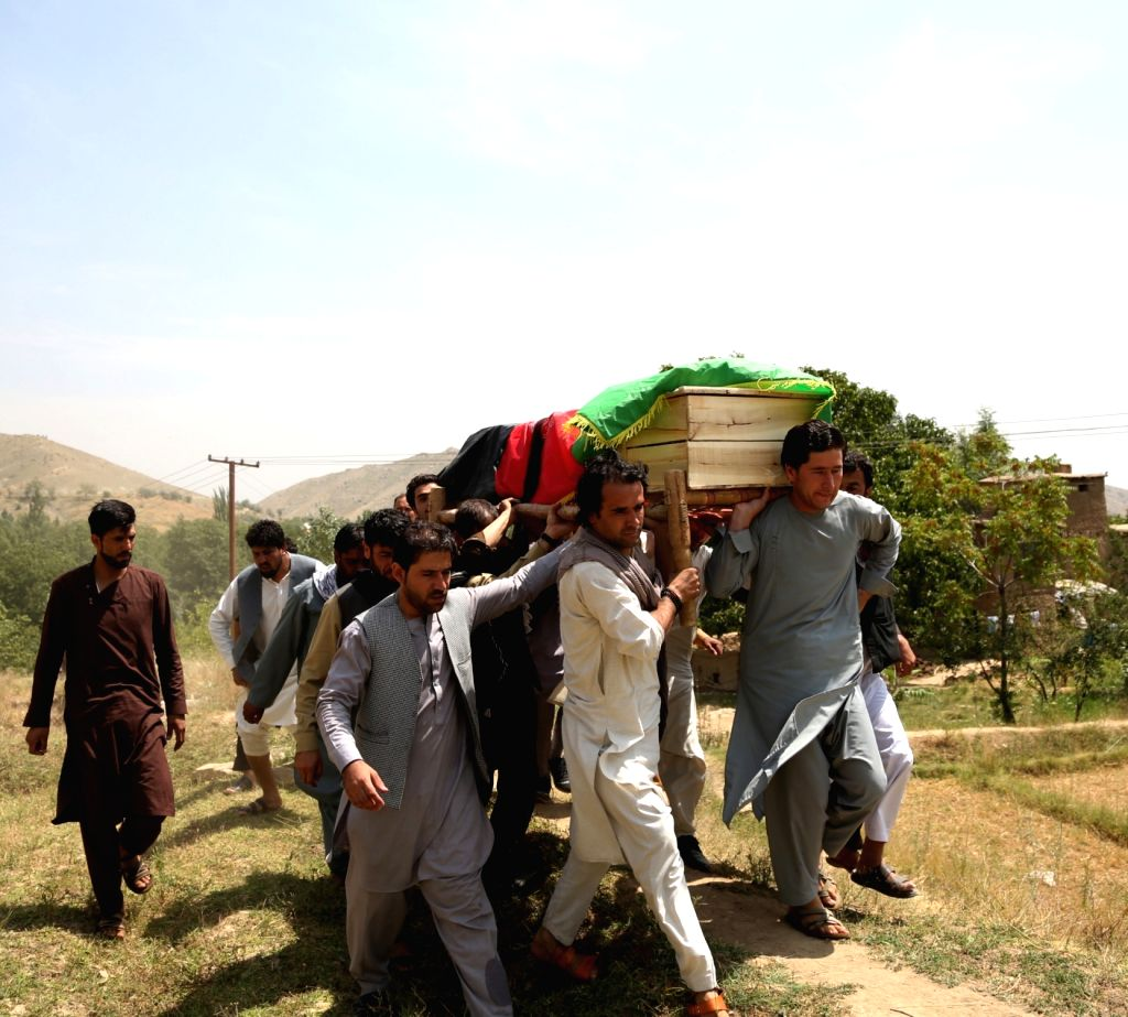 KABUL, July 23, 2018 - Friends and relatives carry the coffin of a suicide attack victim during a funeral in Kabul, capital of Afghanistan, July 23, 2018. At least 14 people were killed and over 60 ...