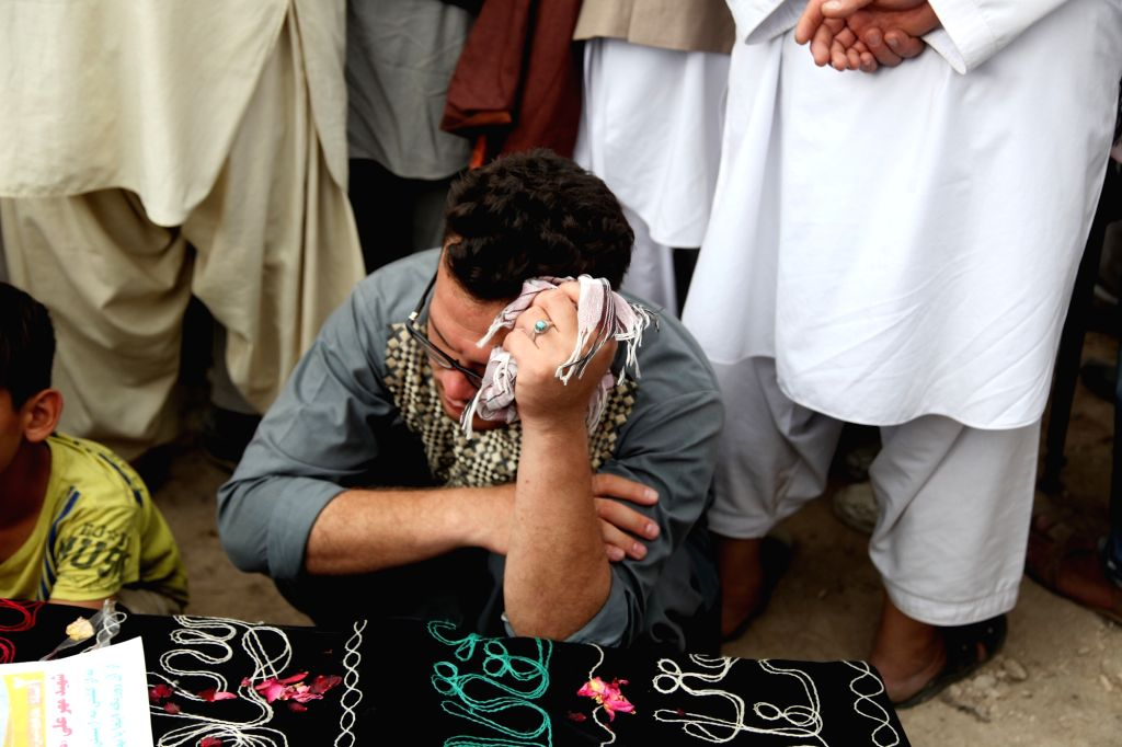 KABUL, July 24, 2016 - A man mourns during a funeral ceremony of the victims of a suicide attack in Kabul, capital of Afghanistan, on July 24, 2016. At least 80 people were killed and more than 200 ...