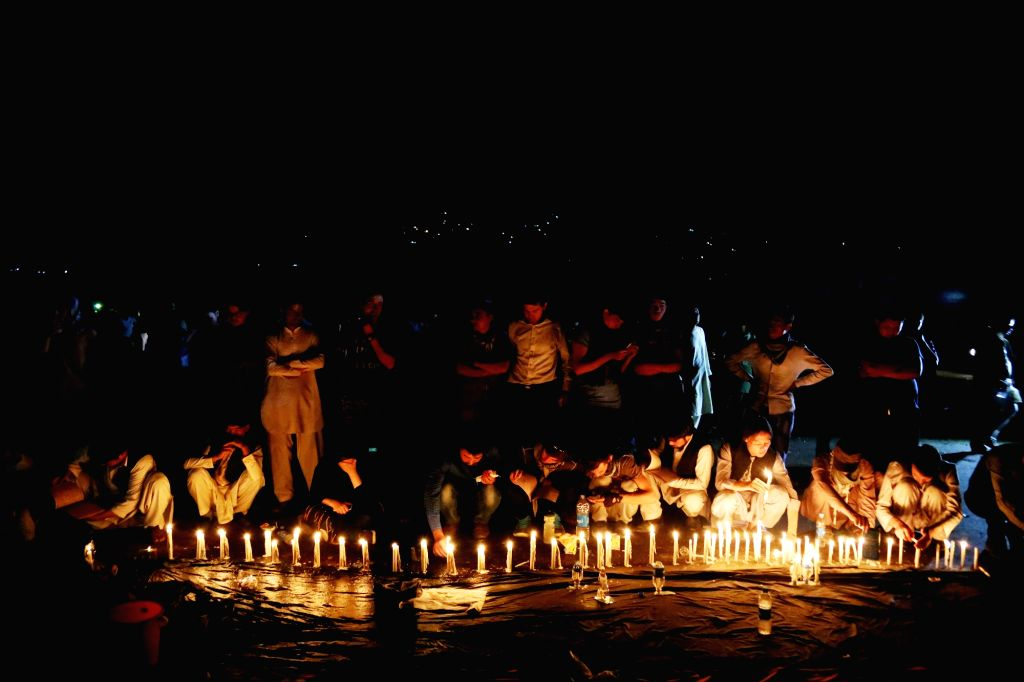 KABUL, July 24, 2016 - People attend a candlelight vigil to commemorate victims of a suicide attack in Kabul, capital of Afghanistan, July 23, 2016. At least 80 people were killed and more than 200 ...