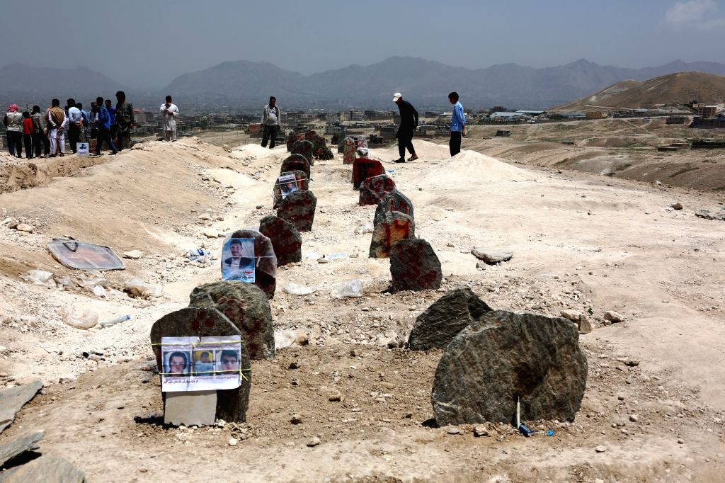 KABUL, July 25, 2016 - Photo taken on July 25, 2016 shows graves of victims of a suicide attack during a funeral ceremony in Kabul, capital of Afghanistan. At least 80 people were killed and more ...