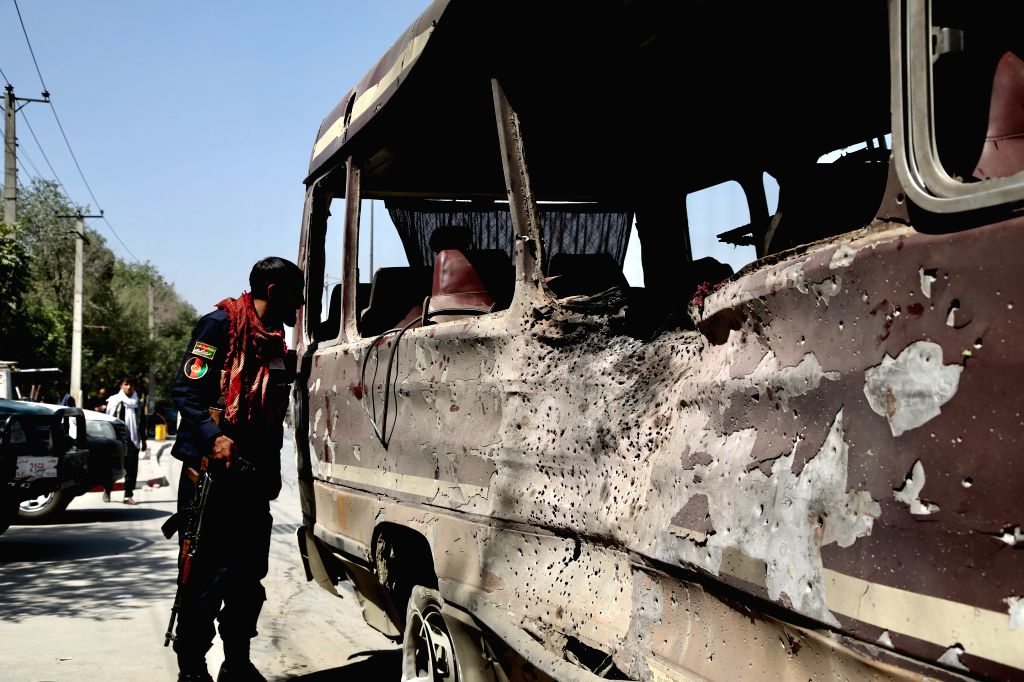 KABUL, July 25, 2019 - A member of Afghan security forces inspects the bus damaged in the blast in Kabul, capital of Afghanistan on July 25, 2019. At least eight people were confirmed dead and 27 ...