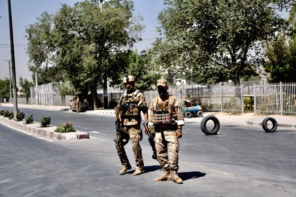 KABUL, July 25, 2019 (Xinhua) -- Members of Afghan security forces stand guard near the site of blast in Kabul, capital of Afghanistan on July 25, 2019. At least eight people were confirmed dead and 27 others injured as three blasts rocked Afghanista