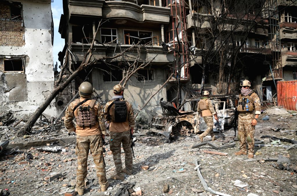 KABUL, July 29, 2019 (Xinhua) -- Afghan security force members inspect at the site of an attack in Kabul, capital of Afghanistan, July 29, 2019. The death toll of a terrorist attack that targeted the office of Afghan President Mohammad Ashraf Ghani's