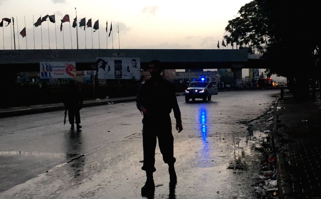 KABUL, July 30, 2016 - Policemen cordon off the blast site in Kabul, capital of Afghanistan, July 29, 2016. At least one person was killed and two others wounded on Friday after a bomb attack rocked ...
