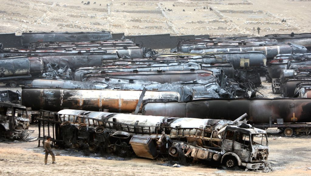 Destroyed oil tankers hit by rockets are seen in Kabul, Afghanistan, July 5, 2014. Hundreds of oil tankers were burned down in Arghandi area on the outskirts of Afghan