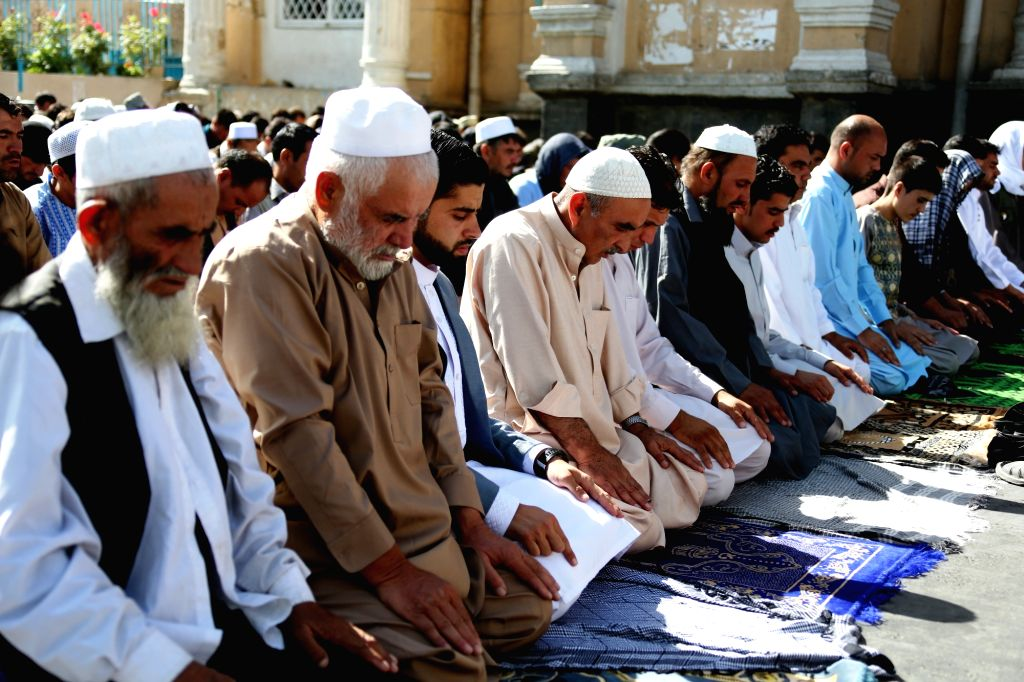 KABUL, July 6, 2016 - Afghan men attend Eid-al-Fitr prayer at a mosque in Kabul, capital of Afghanistan, July 6, 2016. All the big mosques and nearby grounds were packed with faithful Muslims in the ...