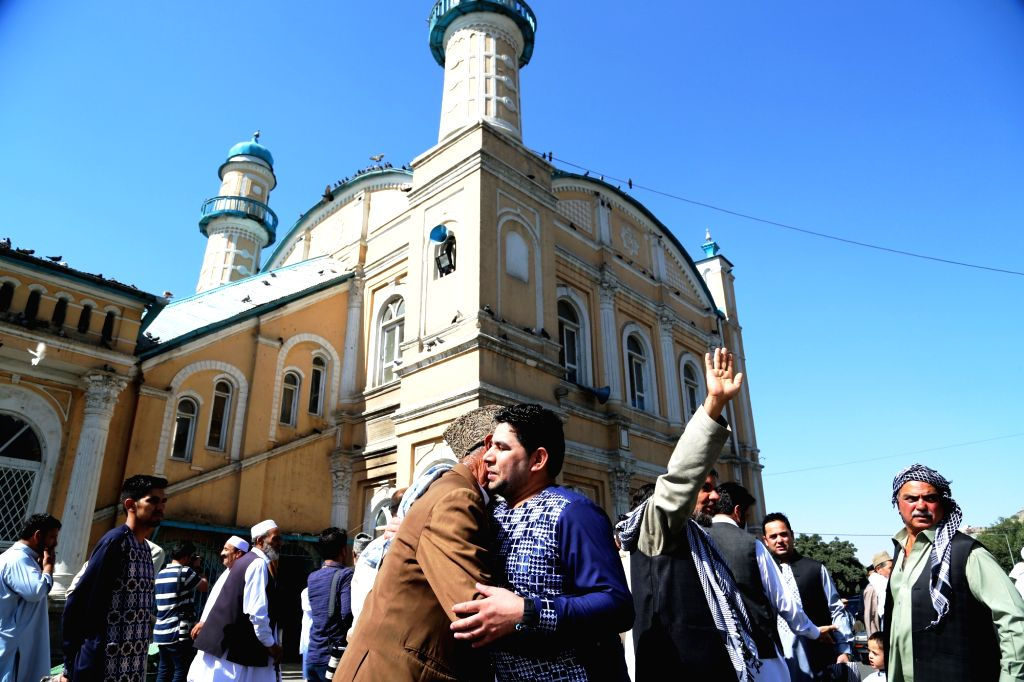 KABUL, July 6, 2016 - Afghan men embrace each other after Eid-al-Fitr prayer at a mosque in Kabul, capital of Afghanistan, July 6, 2016. All the big mosques and nearby grounds were packed with ...