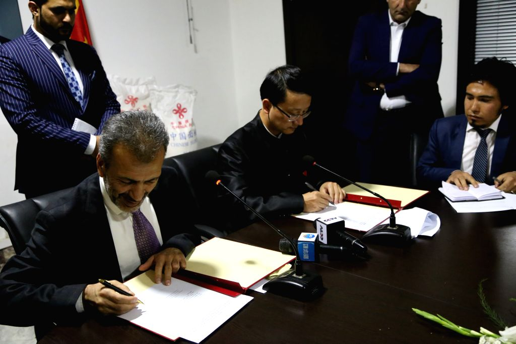 KABUL, June 1, 2019 - Chinese Ambassador to Afghanistan Liu Jinsong (2nd L front) and Afghan National Minister of Disaster Management Najeeb Fahim (1st L front) attend a handover ceremony of ...