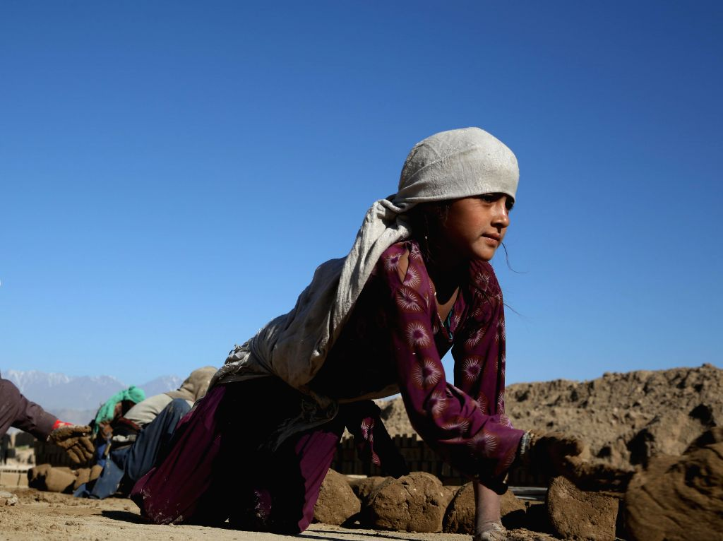 KABUL, June 12, 2019 - An Afghan child works at a brick factory in Kabul, capital of Afghanistan, June 12, 2019. The decades-long war and extreme poverty have taken the toll on Afghan children, with ...