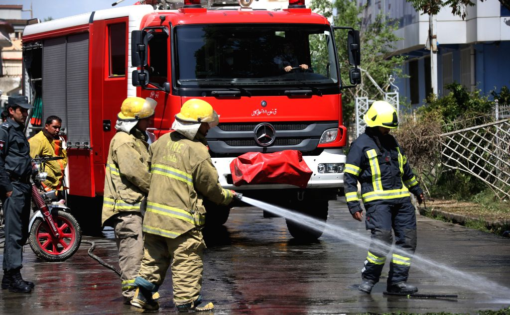 KABUL, June 2, 2019 - Fire fighters wash the site of an attack in Kabul, capital of Afghanistan, June 2, 2019. At least one person lost his life and 17 others sustained injuries as three blasts ...