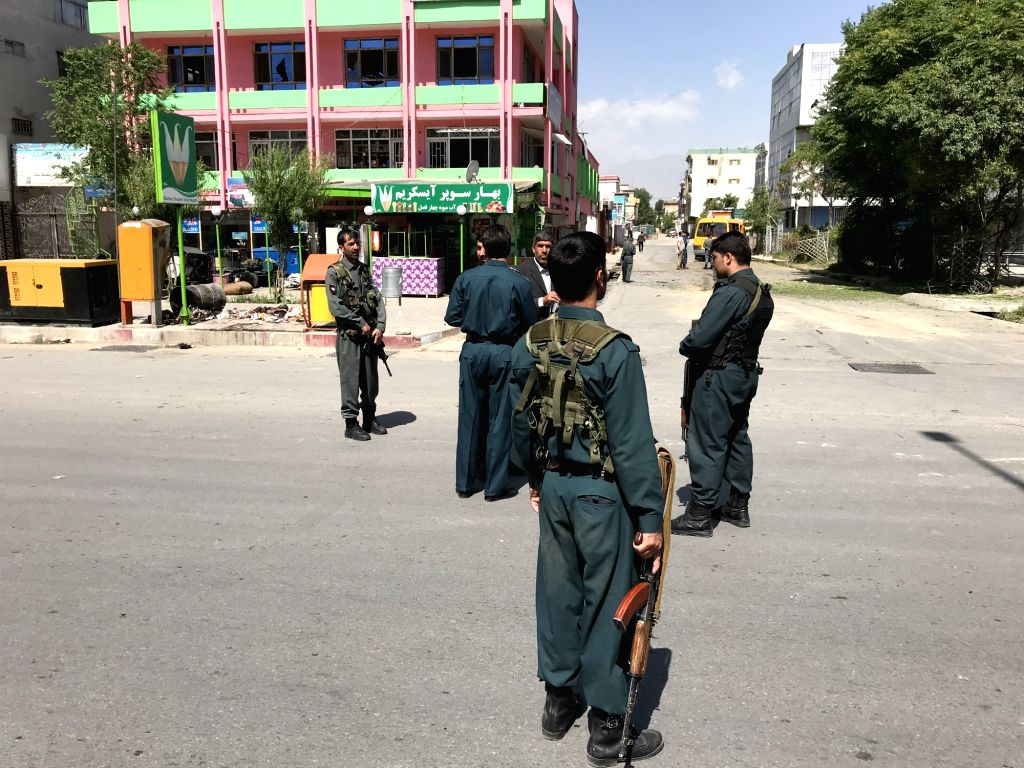 KABUL, June 2, 2019 (Xinhua) -- Afghan policemen inspect the site of serial bomb blasts in western Kabul, capital of Afghanistan, June 2, 2019. At least one person was killed and several others wounded after serial bomb blasts rocked western side of
