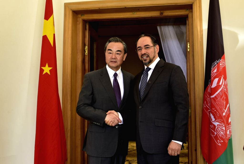 KABUL, June 24, 2017 - Chinese Foreign Minister Wang Yi (L) shakes hands with his Afghan counterpart Salahuddin Rabbani during their meeting in Kabul, capital of Afghanistan, on June 24, 2017. - Wang Y