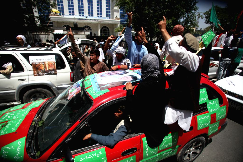 Supporters of Afghan presidential candidate Abdullah Abdullah shout slogans during a protest against alleged election irregularities and fraud in Kabul, Afghanistan, .