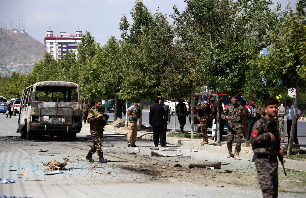 KABUL, June 3, 2019 (Xinhua) -- Afghan security force members inspect the site of an attack in Kabul, Afghanistan, June 3, 2019. Five people were confirmed dead and 10 others sustained injuries as a bomb blast targeted a mini-bus in the western edge