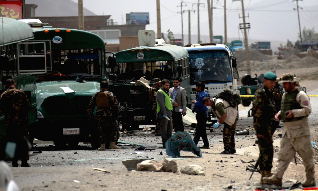KABUL, June 30, 2016 - Afghan security force members inspect the site of a suicide attack in Kabul, Afghanistan, June 30, 2016. Two suicide explosions hit Afghan police convey of five buses in the ...