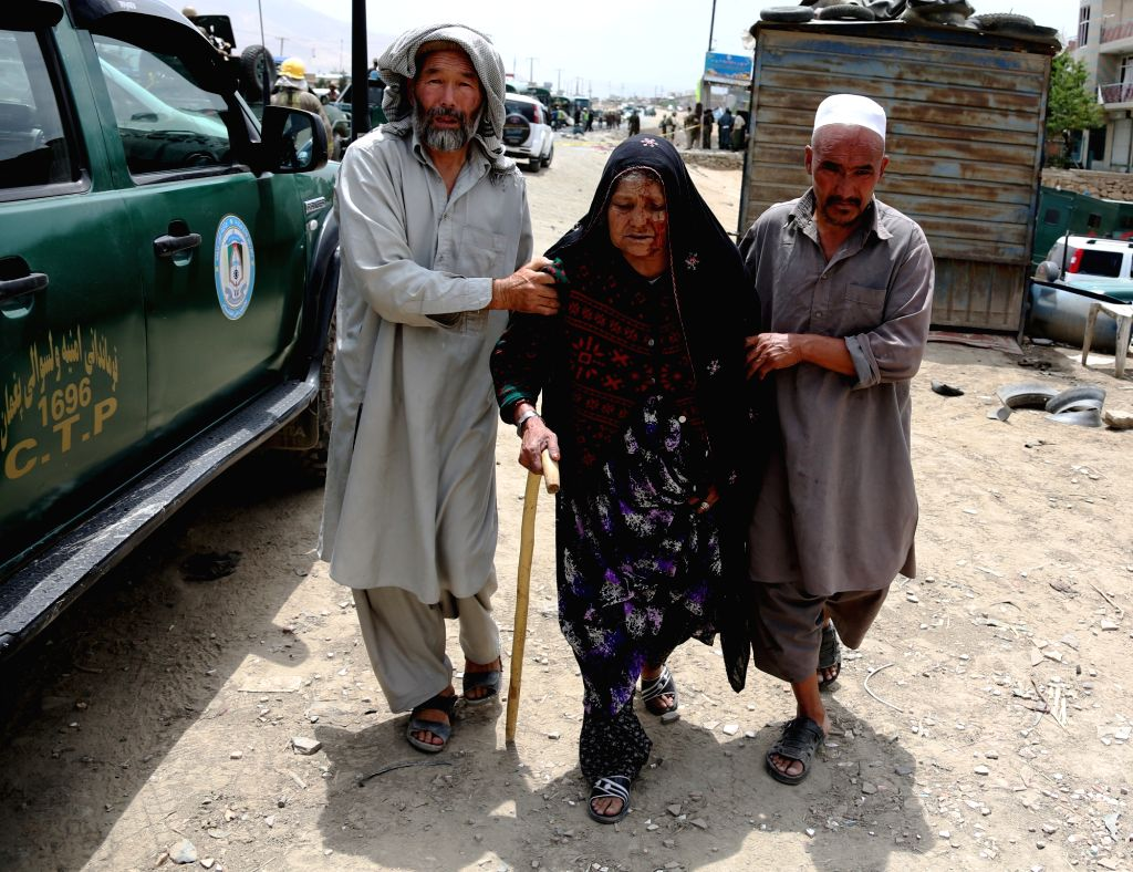 KABUL, June 30, 2016 - People help an injured woman at the site of a suicide attack in Kabul, Afghanistan, June 30, 2016. Two suicide explosions hit Afghan police convey of five buses in the western ...