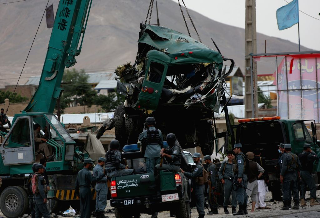 KABUL, June 30, 2016 - Photo taken on June 30, 2016 shows a destroyed bus is taken away from the site of a suicide attack in Kabul, Afghanistan. Two suicide explosions hit Afghan police convey of ...