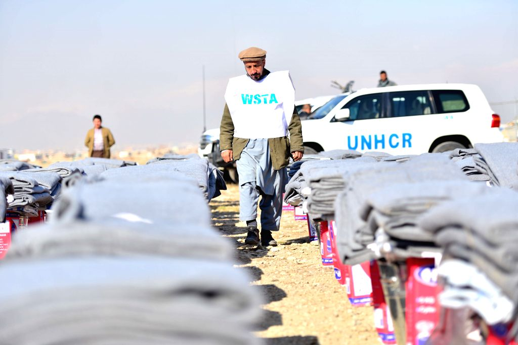 KABUL, March 10, 2017 - A working staff of the UN High Commissioner for Refugees (UNHCR) checks aiding materials donated by Chinese government in Kabul, Afghanistan, March 9, 2017. China on Thursday ...