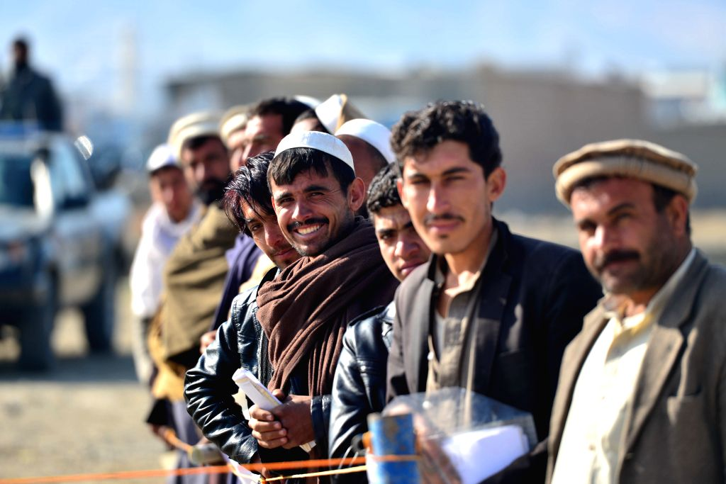 KABUL, March 10, 2017 - Afghan people wait to receive allocated aiding materials donated by Chinese government in Kabul, Afghanistan, March 9, 2017. China on Thursday offered 100 million U.S. dollars ...