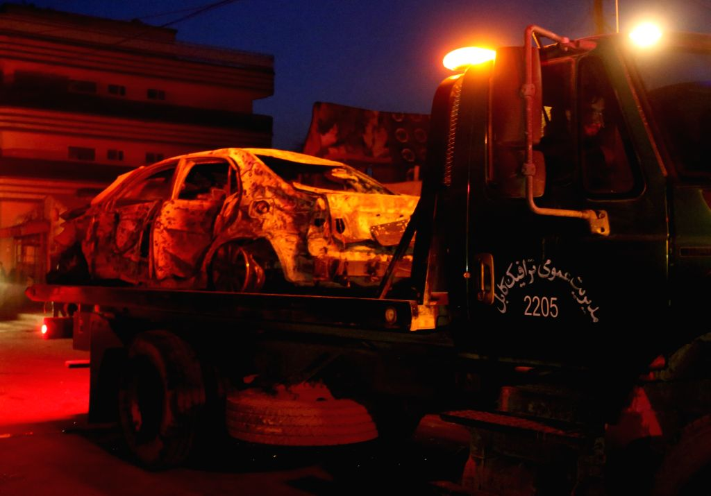 KABUL, March 13, Photo taken on March 13, 2017 shows a destroyed vehicle being taken away from the site of an attack in Kabul, capital of Afghanistan. At least one person has been ...