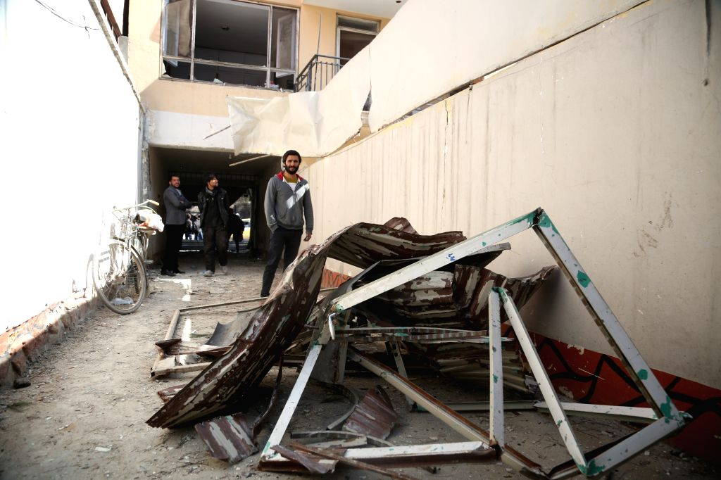 KABUL, March 14, 2017 - Photo taken on March 14, 2017 shows the scene of a damaged building after an attack in Kabul, capital of Afghanistan. At least one person has been confirmed dead and eight ...