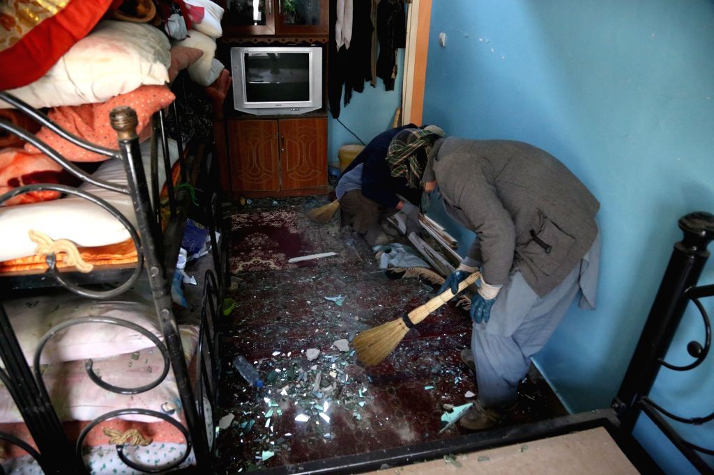 KABUL, March 14, 2017 - Two Afghan men clean a damaged room after an attack in Kabul, capital of Afghanistan, March 14, 2017. At least one person has been confirmed dead and eight others injured ...