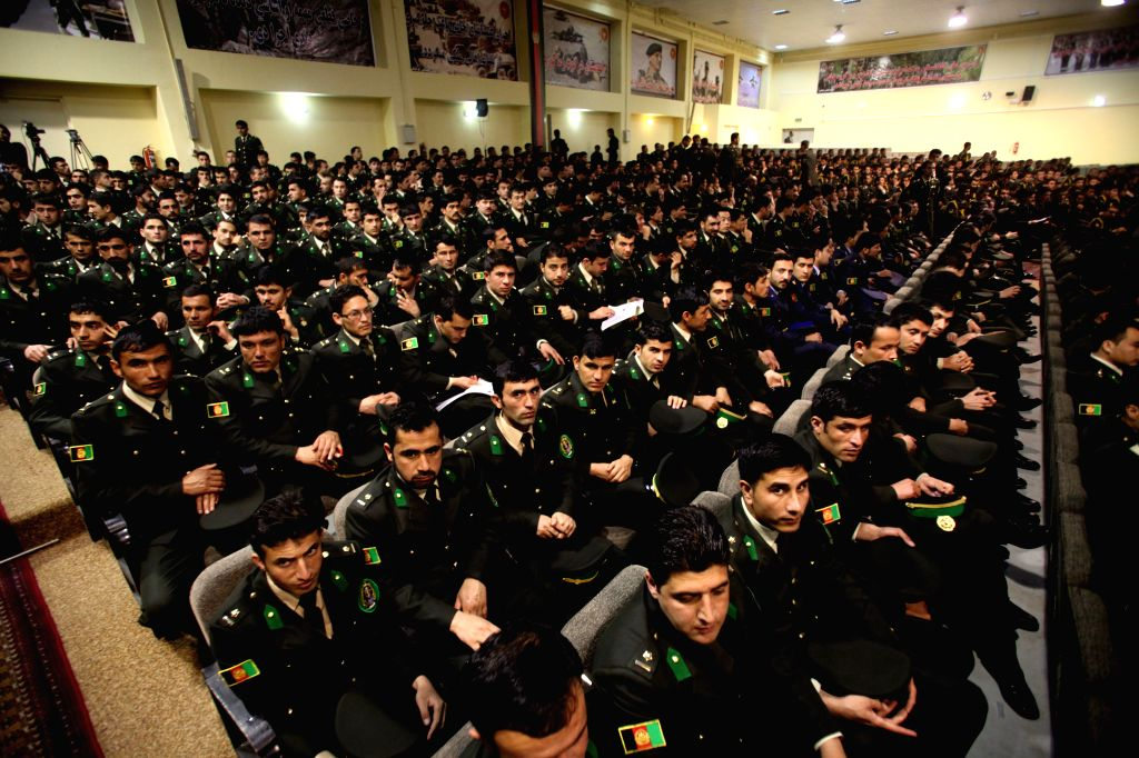 Afghan national army officers attend their graduation ceremony in Kabul, Afghanistan, March 18, 2015. A total of 549 national army officers graduated after four ...