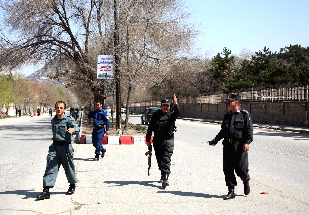 KABUL, March 21, 2018 (Xinhua) -- Afghan policemen walk near the site of a suicide attack in Kabul, capital of Afghanistan, March 21, 2018. Up to 26 people were killed and 18 others wounded after a suicide bomber blew himself up close to the Kabul Un