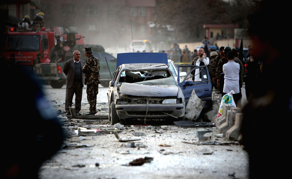 Afghan security forces inspect the site of suicide bombing in Kabul, Afghanistan on March 25, 2015. A suicide bombing that rocked Kabul city on Wednesday killed six ...