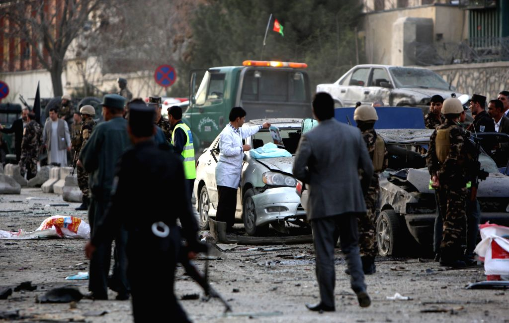 Afghan security forces gather around a destroyed vehicle following a suicide bombing in Kabul, Afghanistan on March 25, 2015. A suicide bombing that rocked Kabul ...