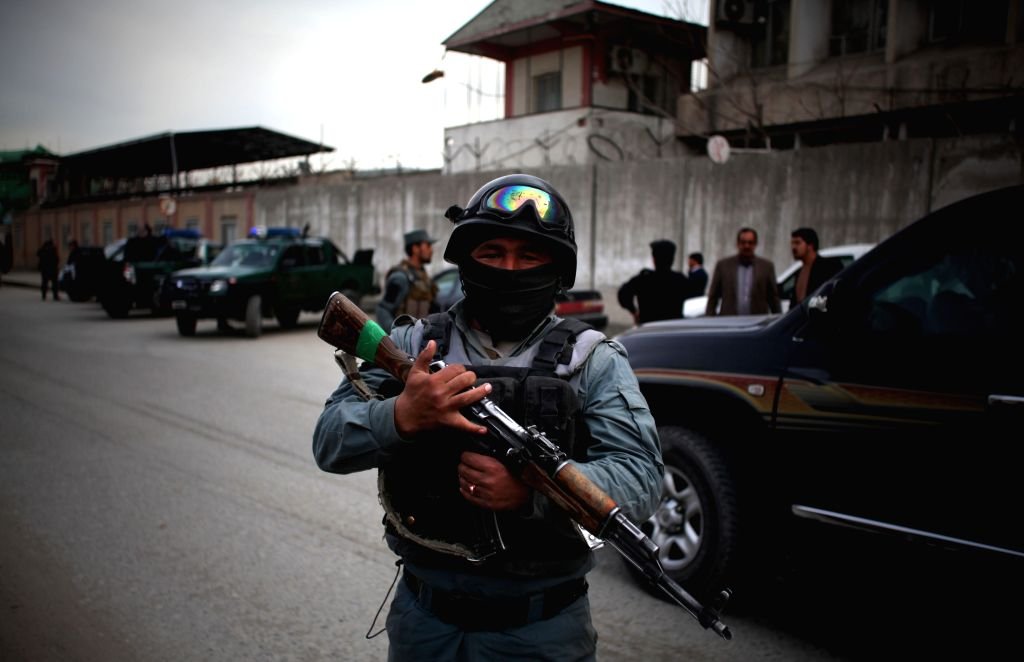 An Afghan policeman stands guard close to the site of suicide bombing in Kabul, Afghanistan on March 25, 2015. A suicide bombing that rocked Kabul city on Wednesday ...