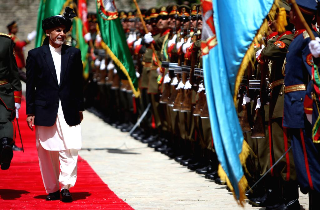 Afghan President Mohammad Ashraf Ghani inspects guards of honor during a ceremony marking the 23rd anniversary of the Mujahidin victory against the Soviet Union in ...