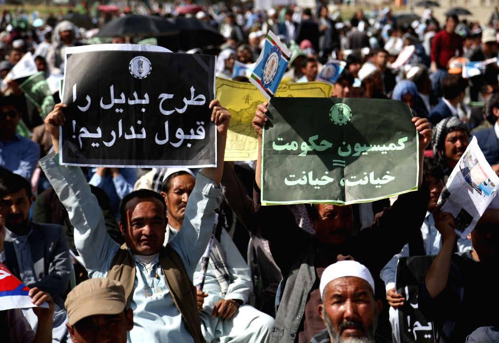 KABUL, May 28, 2016 - Afghan protesters hold posters opposing to the government's decision in Kabul, capital of Afghanistan, May 27, 2016. Thousands of Afghans gathered at a mosque west of Kabul on ...