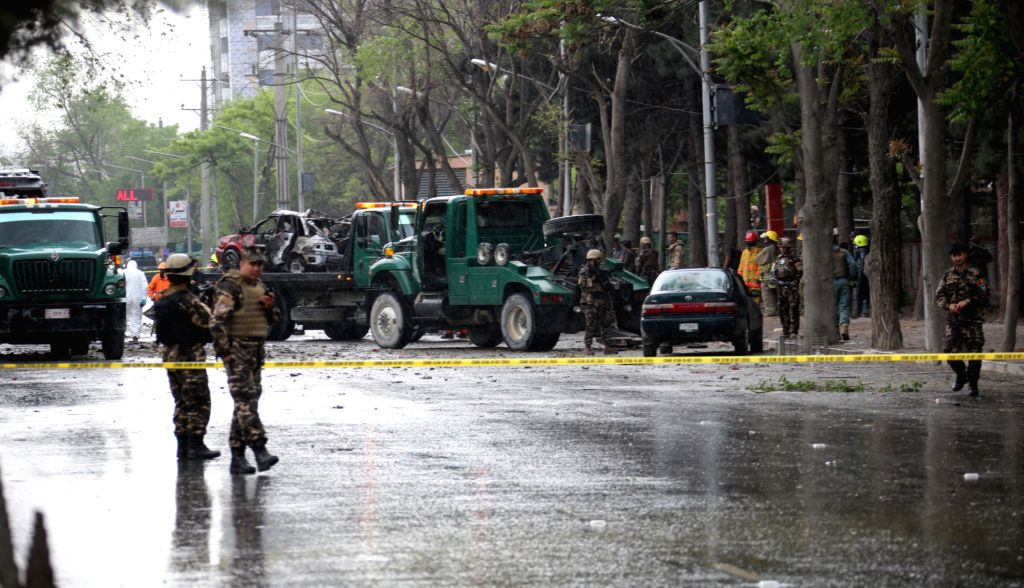 KABUL, May 3, 2017 - Afghan security personnel inspect the site of an attack in Kabul, capital of Afghanistan, May 3, 2017. Eight civilians were killed and 27 others injured after a suicide bomber ...