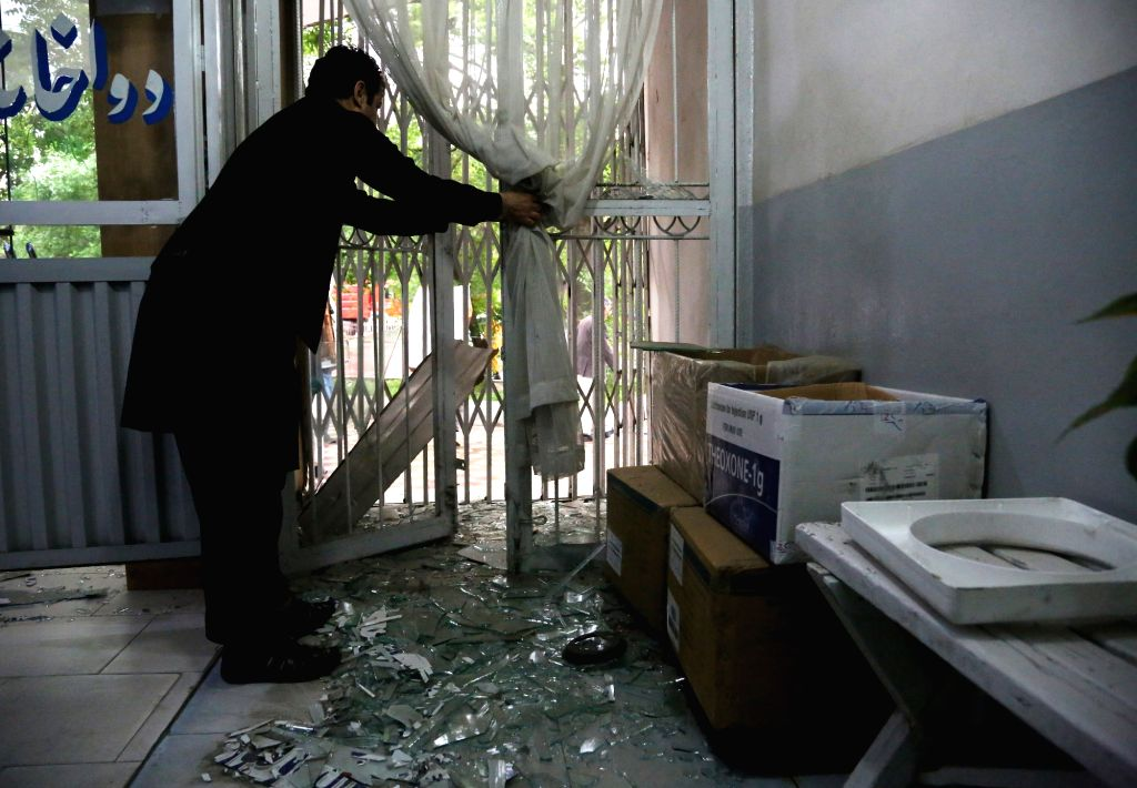KABUL, May 3, 2017 - An Afghan man cleans his shop near the site of an attack in Kabul, capital of Afghanistan, May 3, 2017. Eight civilians were killed and 27 others injured after a suicide bomber ...