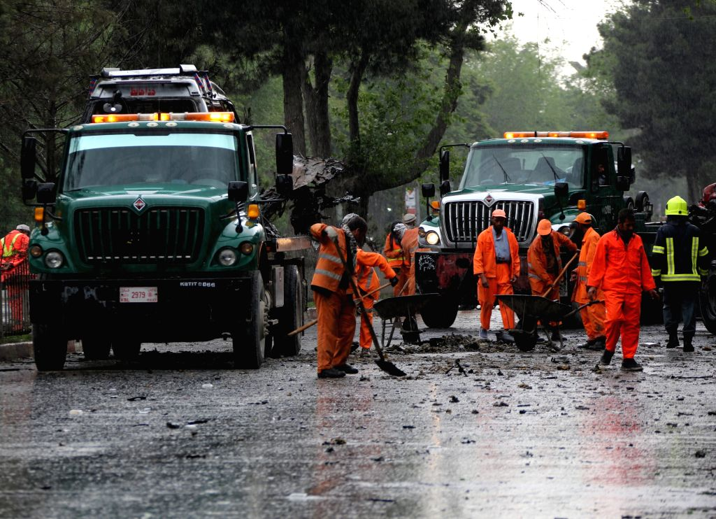KABUL, May 3, 2017 - Workers clean the site of an attack in Kabul, capital of Afghanistan, May 3, 2017. Eight civilians were killed and 27 others injured after a suicide bomber struck a foreign ...