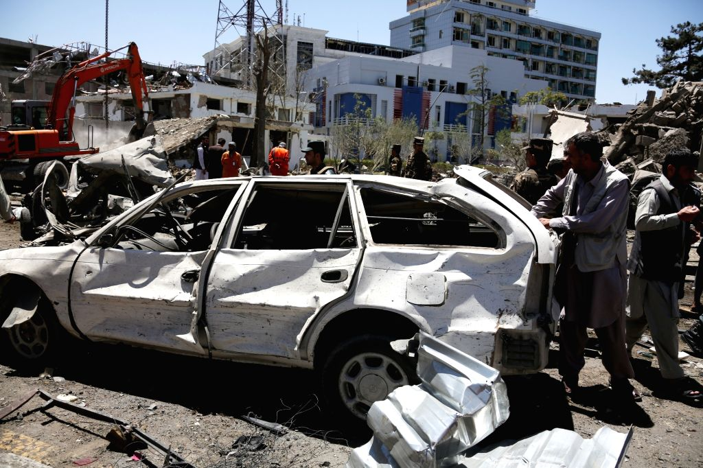 KABUL, May 31, 2017 - An Afghan man inspects a damaged car at the site of a car bomb explosion in Kabul, capital of Afghanistan, May 31, 2017. At least 64 people were killed and 320 others injured in ...