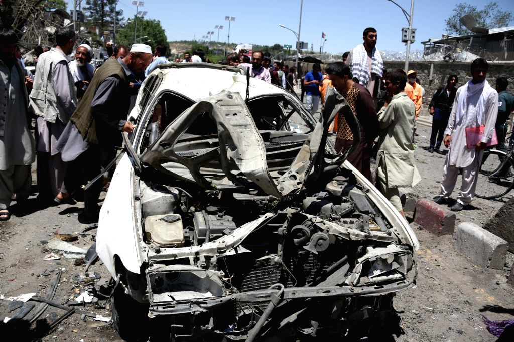 KABUL, May 31, 2017 - Civilians gather at the site of a car bomb explosion in Kabul, capital of Afghanistan, May 31, 2017. At least 64 people were killed and 320 others injured in Wednesday morning's ...