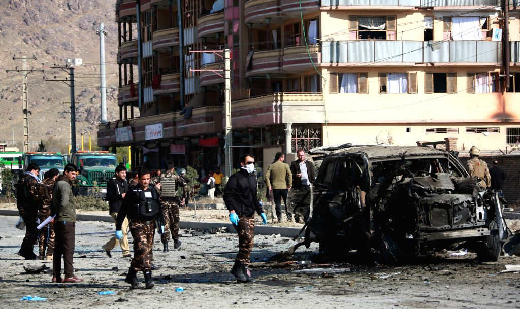 KABUL, Nov. 13, 2019 - Afghan security force members inspect the site of an attack in Kabul, capital of Afghanistan, Nov. 13, 2019. A large explosion ripped through a busy road in Qasaba neighborhood ...