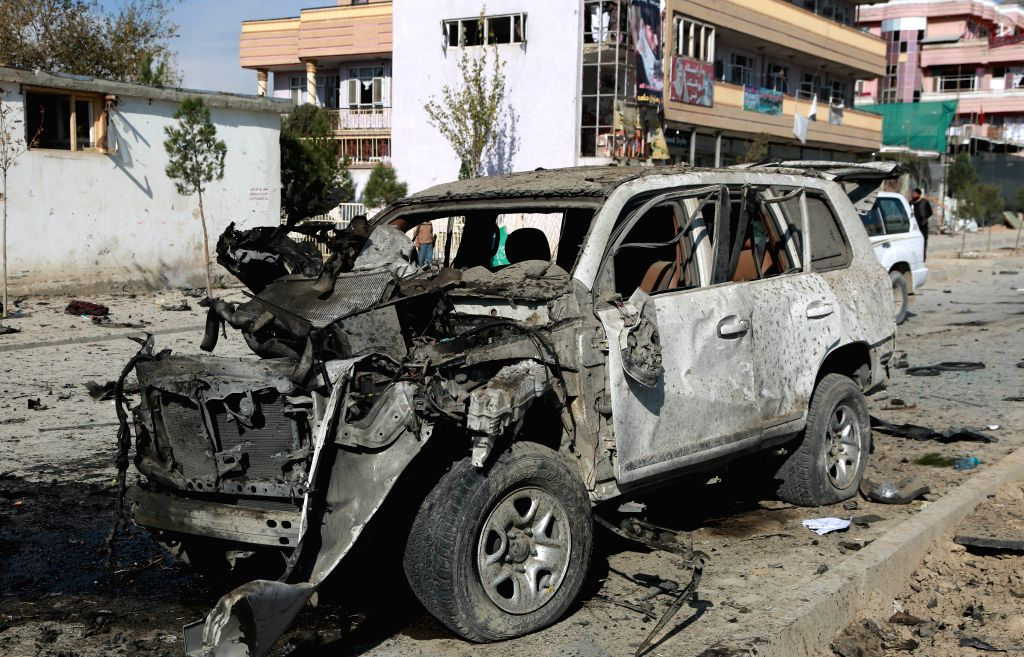KABUL, Nov. 13, 2019 - Photo taken on Nov. 13, 2019 shows a damaged vehicle at the site of an attack in Kabul, capital of Afghanistan. A large explosion ripped through a busy road in Qasaba ...