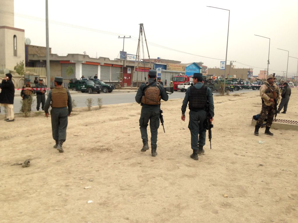 KABUL, Nov. 21, 2016 - Policemen patrol around a Shiite mosque in the western part of Kabul, capital of Afghanistan, Nov. 21, 2016. At least 27 people were killed and 35 others wounded after a ...