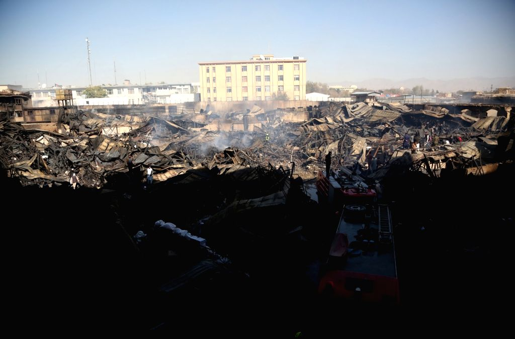KABUL, Nov. 3, 2018 - Photo taken on Nov. 3, 2018 shows the site of the fire in Kabul, Afghanistan. Hundreds of shops have been burnt down as a massive fire engulfed a market in a main business hub ...