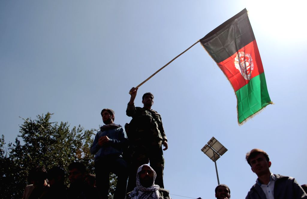 KABUL, Oct. 1, 2015 (Xinhua) -- An Afghan protester holds an Afghanistan national flag during an anti-Taliban protest in Kabul, Afghanistan, Oct. 1, 2015. Thousands of Afghans including men and women staged a peaceful demonstration in Afghan capital