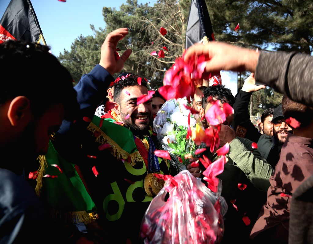 KABUL, Oct. 11 Afghan body building champion Ahmad Yasin Salik Qaderi (C) who claimed the title of Mr. Universe 2017 in Mongolia's Ulaanbaatar, is welcomed during a celebrating tour in ...