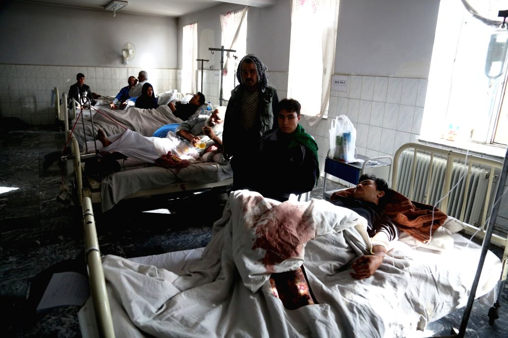 KABUL, Oct. 12, 2016 - Afghan injured men receive medical treatment at a hospital in Kabul, capital of Afghanistan, Oct. 12, 2016. At least 14 people were killed and over 40 injured Tuesday night ...