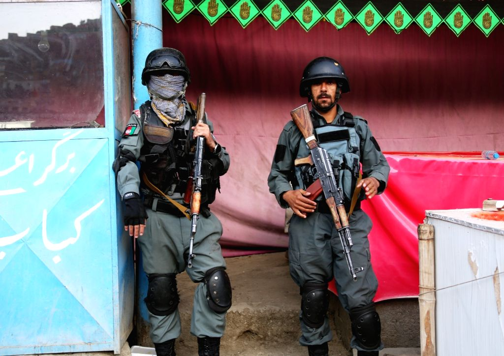 KABUL, Oct. 12, 2016 - Afghan policemen stand guard near the site of militants attacked in Kabul, capital of Afghanistan, Oct. 12, 2016. At least 14 people were killed and over 40 injured Tuesday ...