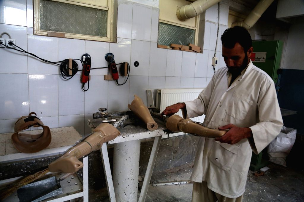 KABUL, Oct. 25, 2016 - An Afghan medical worker makes prosthetic legs at the Orthopedic Center of the International Committee of the Red Cross (ICRC) in Kabul, capital of Afghanistan, Oct. 25, 2016. ...