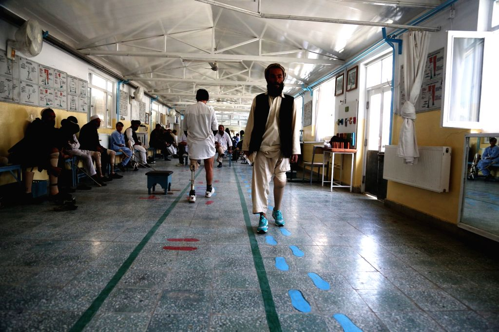 KABUL, Oct. 25, 2016 (Xinhua) -- Disabled men walk with their prosthetic legs at the Orthopedic Center of the International Committee of the Red Cross (ICRC) in Kabul, capital of Afghanistan, Oct. 25, 2016. More than 2,560 civilians were killed and o